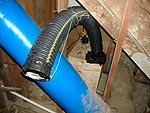 Within basement space: fan at end of tube, plywood box, socket and converter