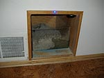 Cat-box built into dead space under stairs.  Plexiglass liner is waterproof